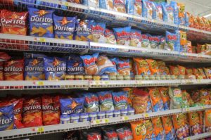 Shelves of potato chips for sale at Walmart.