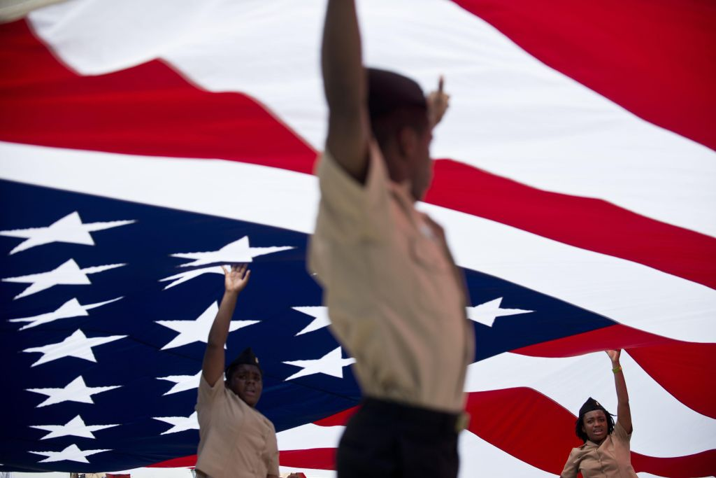 Members of the US Navy's JROTC hold up a