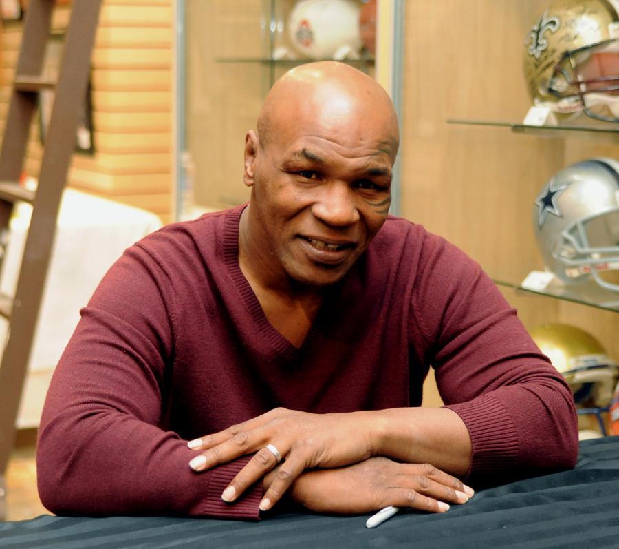Tyson Signs Autographs In Las Vegas